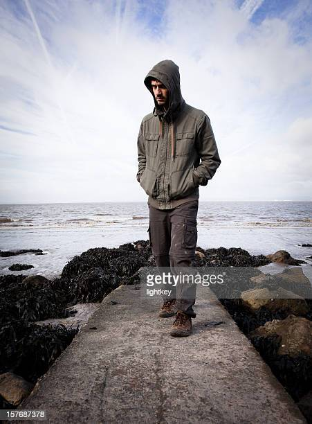mysterious man walking towards you - hoodie stock pictures, royalty-free photos & images
