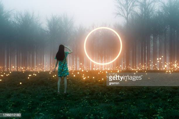 mysterious meadow passage - illuminated stock pictures, royalty-free photos & images