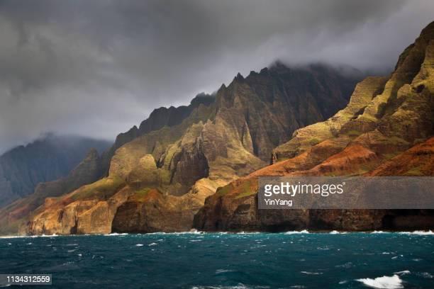 mysterious misty na pali coast and waimea canyon, kauai, hawaii - na pali stock photos and pictures