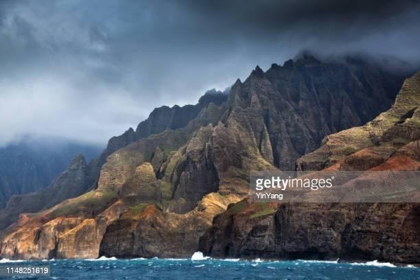 mysterious misty na pali coast and waimea canyon, kauai, hawaii - na pali coast stock photos and pictures