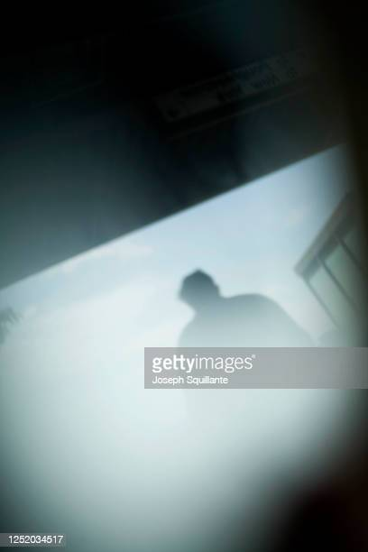 mysterious shadow man walking - joseph squillante stock pictures, royalty-free photos & images