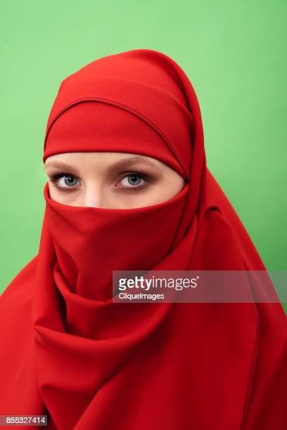 mysterious woman in niqab - cliqueimages stock pictures, royalty-free photos & images