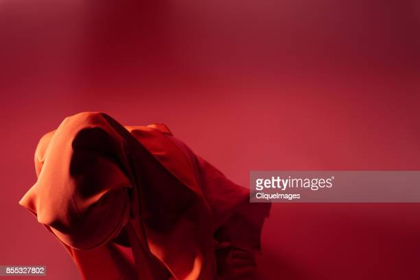 mysterious woman in red headscarf - cliqueimages stock pictures, royalty-free photos & images
