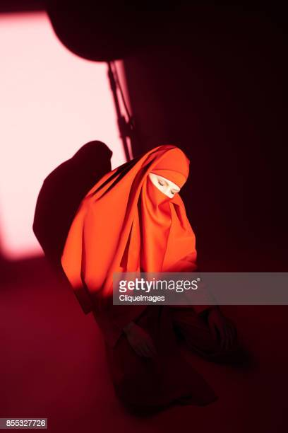 mysterious woman in red niqab - cliqueimages stock pictures, royalty-free photos & images