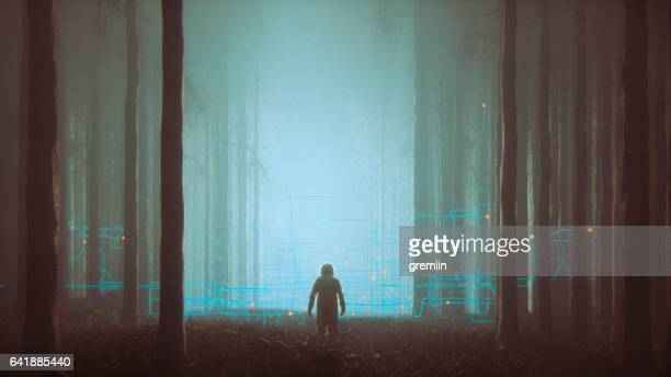 mystery forest with lost astronaut - alien stock photos and pictures