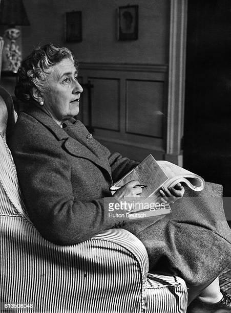Mystery writer Agatha Christie corrects the proofs of her latest book in her study at Greenway House