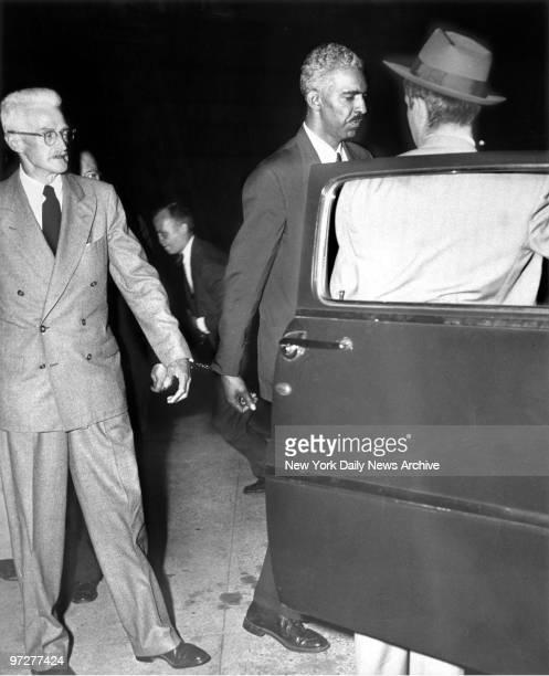Mystery writer Dashiell Hammett is handcuffed to fellow Civil Rights Congress representative W Alphaeus Hunton as he approaches car at Federal Court...
