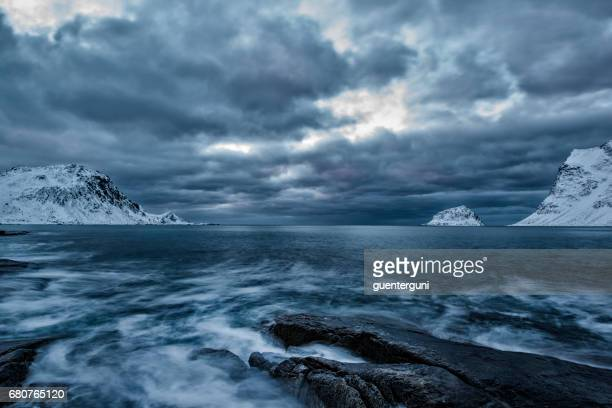 mystic beach in winter at the nordic atlantic ocean - norway stock pictures, royalty-free photos & images