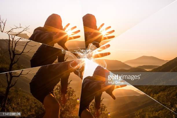 mystic picture of guy playing with sunlight during sunrise in the nature seen through a broken mirror. - 鏡 物品 個照片及圖片檔
