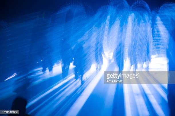 mystic picture of silhouette of people walking at night with blue light. - holy city stock pictures, royalty-free photos & images