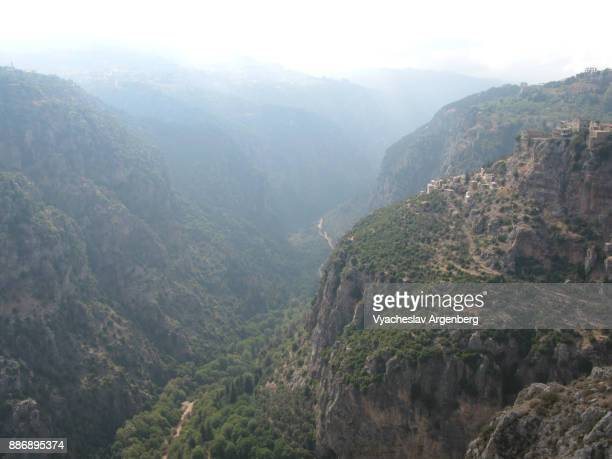 a mystical canyon of qadisha (holy) valley in northern lebanon - argenberg stock pictures, royalty-free photos & images