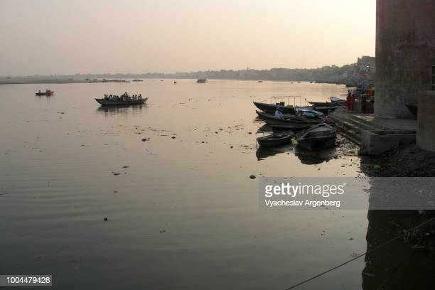 mystical ethereal atmosphere in the eternal city of varanasi, sacred river ganges after sunset, india - argenberg stock pictures, royalty-free photos & images