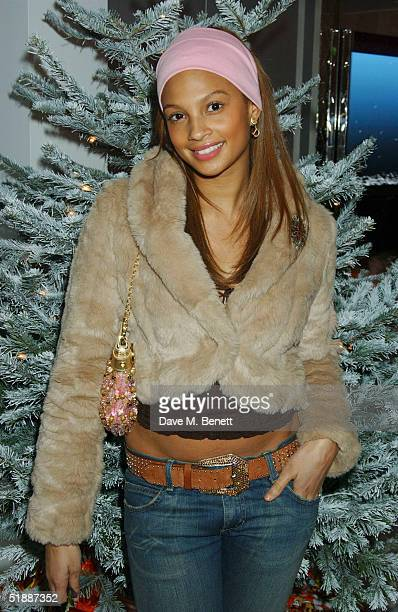 Mystique's Aleesha Dixon poses at the Nutcracker Ballet gala preparty at St Martins Lane Hotel December 21 London