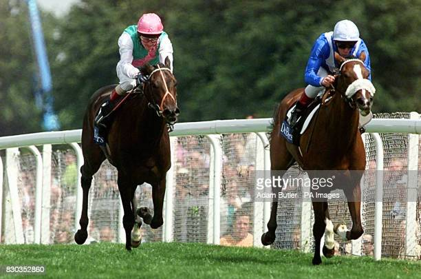 Mythical Girl ridden by Frankie Dettori en route to victory in the Princess Margaret Stakes from Rustic ridden by Michael Kinane at Ascot this...