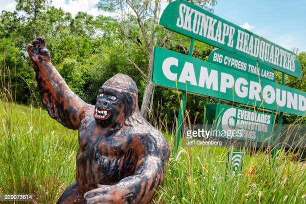 A mythical sculpture in front of Skunk Ape Research Center Headquarters sign