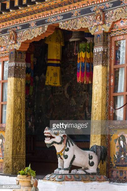 Mythical Tibetan snow lion guards the entrance to the Buddhist temple in Punakha, Bhutan.