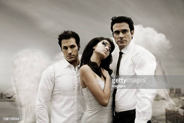 mythical trio - male angel stock photos and pictures