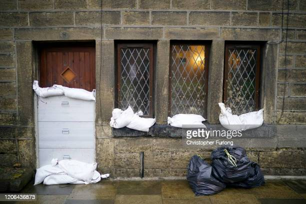 Mytholmroyd residents defend their homes as soldiers arrive to help shore up flood barriers and Storm Dennis begins to make landfall in the UK on...