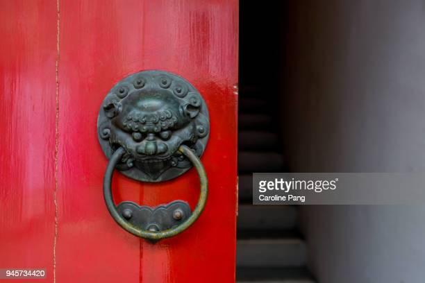Mythological Chinese dragon head doorknob.