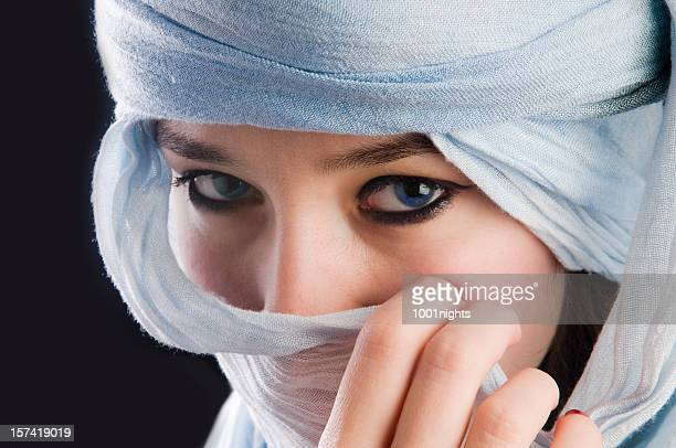 mytserious blue eyes behind tuareg - iranian woman stock photos and pictures
