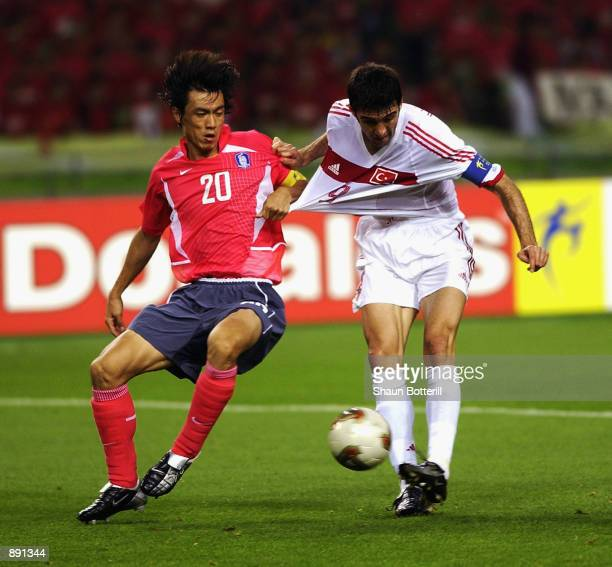 Myung Bo Hong of South Korea pulls the shirt of Hakan Sukur of Turkey during the FIFA World Cup Finals 2002 Third Place PlayOff match played at the...