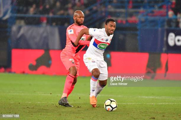Myziane Maolida of Lyon and Baissama Sankoh of Caen during the French Cup match between Caen and Lyon at Stade Michel D'Ornano on March 1 2018 in...