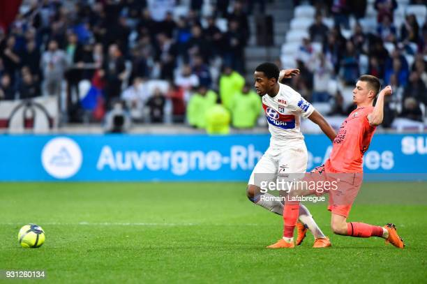 Myziane Maolida of Lyon and Frederic Guilbert of Caen during the Ligue 1 match between Olympique Lyonnais and SM Caen at Parc Olympique on March 11...