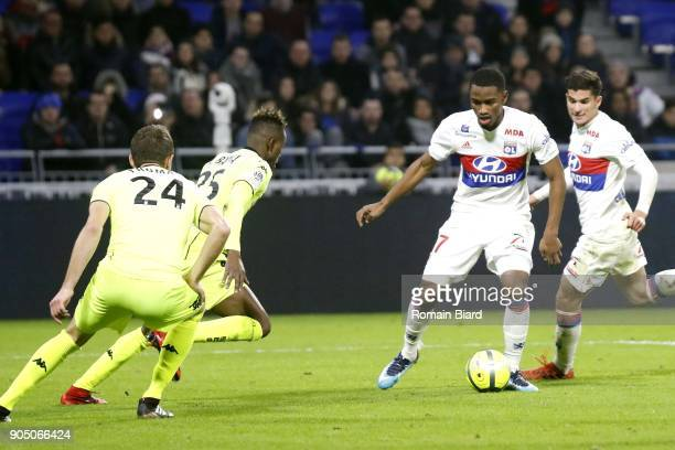 Myziane Maolida of Lyon and Houssem Aouar of Lyon and Abdoulaye Bamba of Angers and Romain Thomas of Angers Photo by Romain Biard / Icon Sport