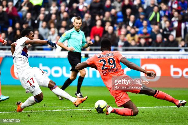 Myziane Maolida of Lyon and Romain Genevois of Caen during the Ligue 1 match between Olympique Lyonnais and SM Caen at Parc Olympique on March 11...