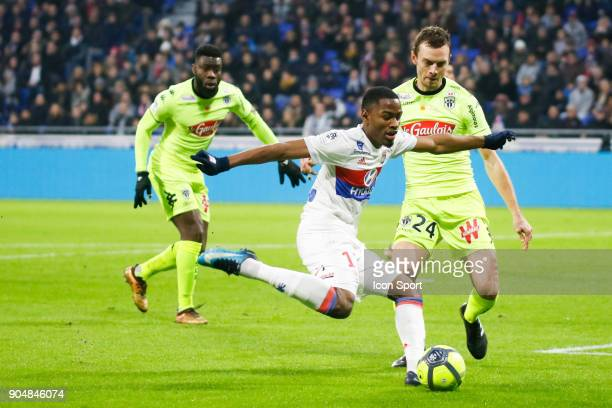 Myziane Maolida of Lyon and Romain Thomas of Angers during the Ligue 1 match between Lyon and Angers at Groupama Stadium on January 14 2018 in Lyon...