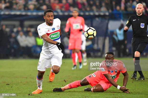 Myziane Maolida of Lyon and Tiemoko Ismael Diomande of Caen during the French Cup match between Caen and Lyon at Stade Michel D'Ornano on March 1...