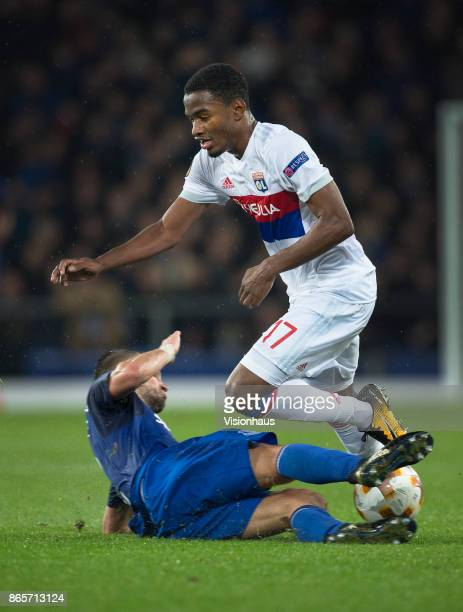 Myziane Maolida of Olympique Lyon is tackled by Morgan Schneiderlin of Everton during the UEFA Europa League group E match between Everton FC and...