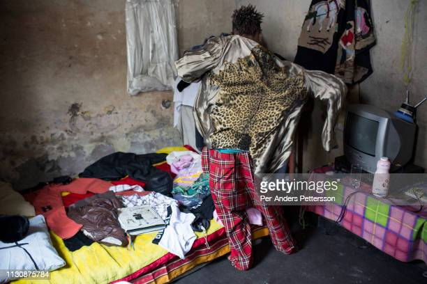 Mzee Kindingu the leader of Sapeur group The Leopards dress up in a Versace jacket in his bedroom on February 3 2015 in Kinshasa DRC The word Sapeur...
