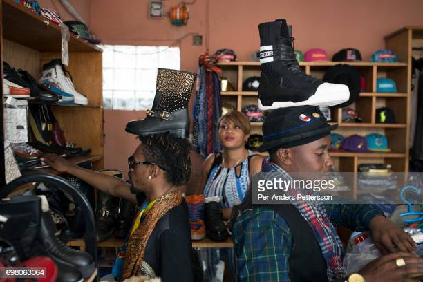 Mzee Kindingu the leader of the Sapeurs group The Leopards shops for shoes in one of the fashion shops in Matonge area February 12 2016 in Kinshasa...