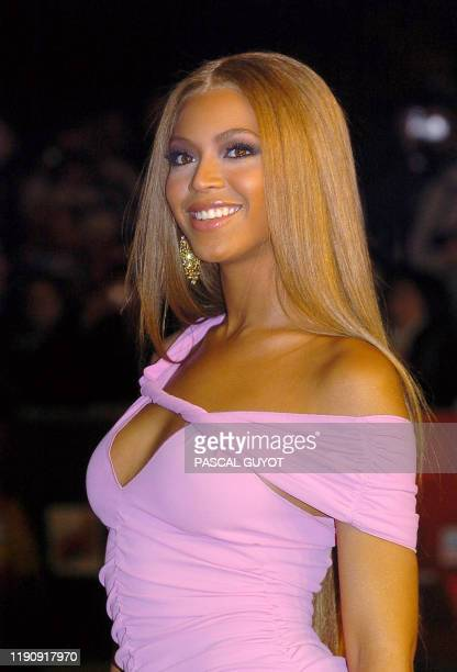 US R'n B star Beyonce Knowles arrives 24 January 2004 at Cannes' Palais des Festivals for France's annual NRJ music awards The awards are held as the...