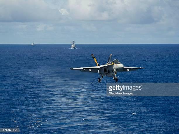 n F/A-18E Super Hornet prepares to make an arrested landing.