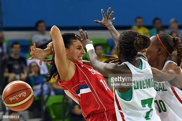 N Serbia's shooting guard Ana Dabovic, Senegal's point guard Fatou Dieng and Senegal's power forward Astou Traore go for the ball during a Women's...