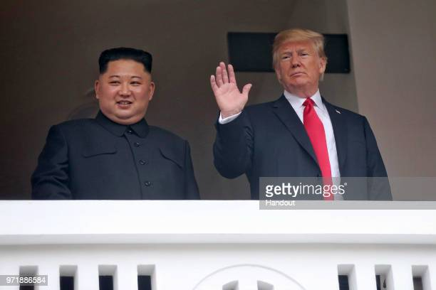 n this handout photograph provided by The Strait Times North Korean leader Kim Jongun with US President Donald Trump during their historic USDPRK...