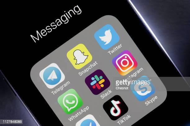 N this photo illustration, the logos of the messaging applications Telegram, Snapchat, Twitter, WhatsApp, Slack, Instagram, Messenger, TikTok and...