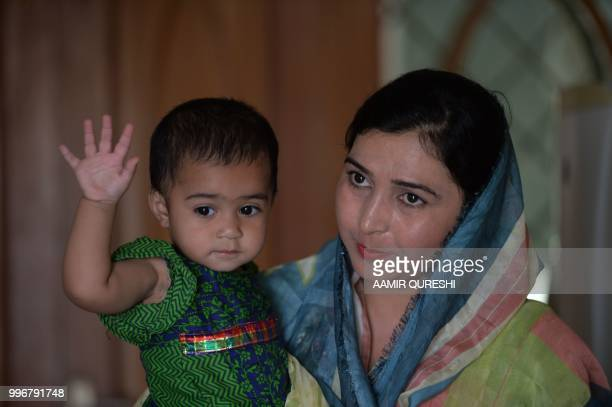 n this picture taken on July 6 Pakistani woman Fouzia Talib who voted in a local government election in 2015 in Mohri Pur holds her daughter at her...