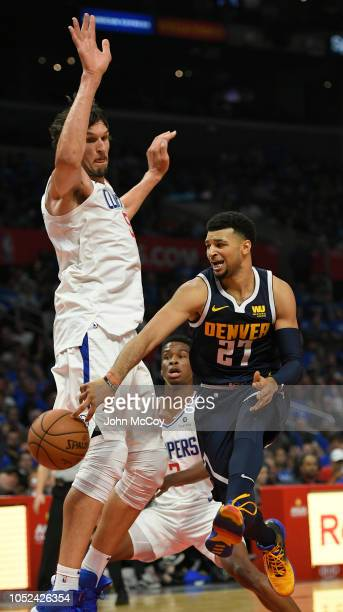 n21 passes the ball around Boban Marjanovic of the LA Clippers in the second half during the season opening game at Staples Center on October 17 2018...