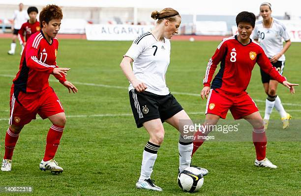 n7 Melanie Behringer of Germany challenges n17 Pang Fengyue and n8 Ma Jun of China during the Women Algarve Cup match between Germany and China on...