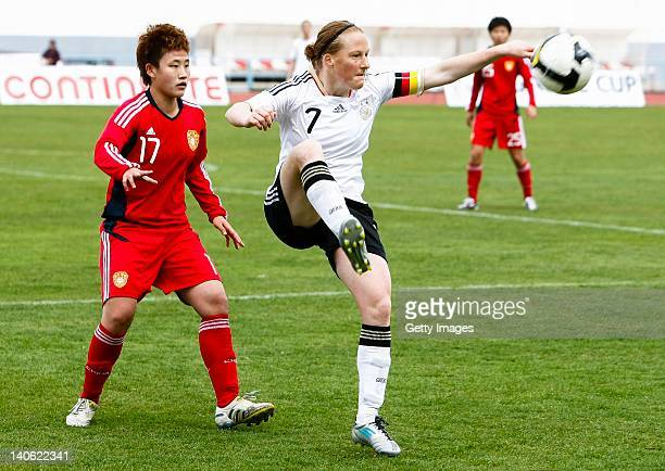 n7 Melanie Behringer of Germany challenges n17 Pang Fengyue of China during the Women Algarve Cup match between Germany and China on March 2 2012 in...