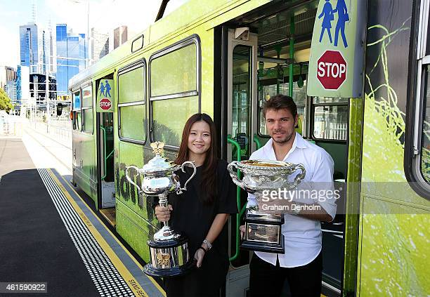 Na Li of China and Stan Wawrinka of Switzerland pose with the Daphne Akhurst Memorial Cup and the Norman Brookes Challenge Cup as they arrive for the...