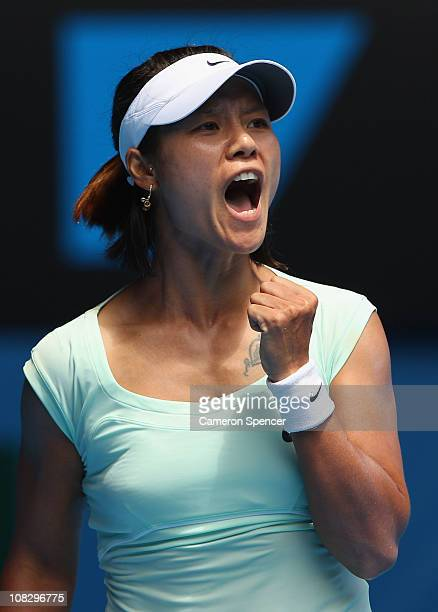 Na Li of China celebrates match point in her quarterfinal match against Andrea Petkovic of Germany during day nine of the 2011 Australian Open at...