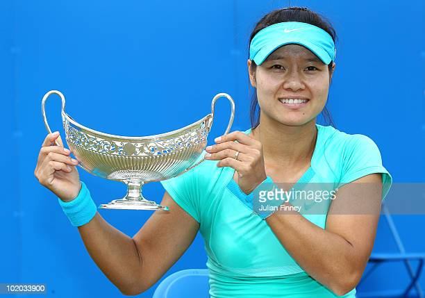 Na Li of China celebrates with the trophy after defeating Maria Sharapova of Russia in the Women's Singles final during the AEGON Classic Tennis at...