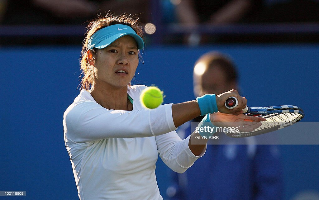 Na Li of China hits a shot during her women's first round singles match against Elena Baltacha of Great Britain on the second day of the AEGON International tennis tournament in Eastbourne, southern England, on June 15, 2010.