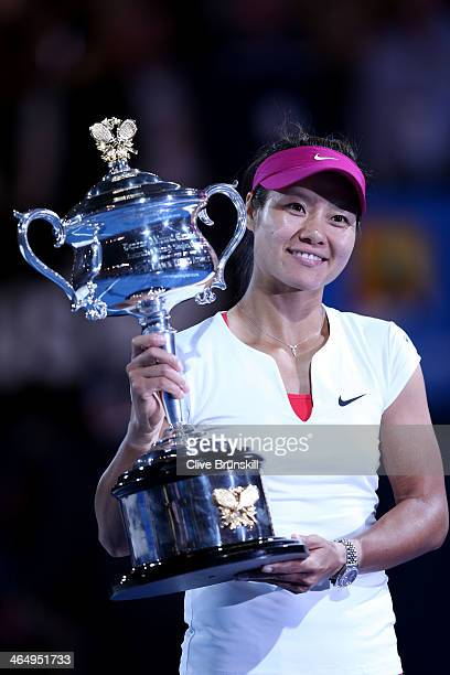 Na Li of China holds the Daphne Akhurst Memorial Cup after winning the women's final match against Dominika Cibulkova of Slovakia during day 13 of...