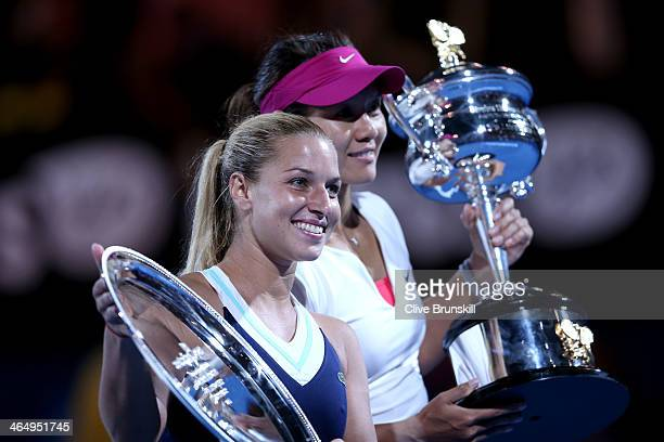 Na Li of China holds the Daphne Akhurst Memorial Cup after winning the women's final match, and Dominika Cibulkova of Slovakia holds the runner up...
