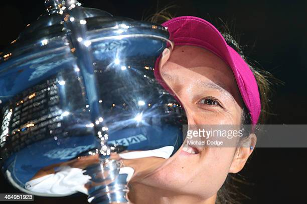 Na Li of China kisses the Daphne Akhurst Memorial Cup after winning the women's final match against Dominika Cibulkova of Slovakia during day 13 of...